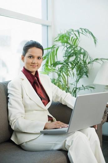 Businesswoman using a laptop : Stock Photo