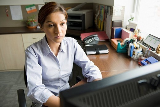 Stock Photo: 1846-9370 Businesswoman working on a computer in an office