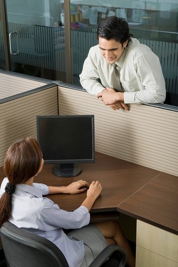 Stock Photo: 1846-9403 Two business executives talking in an office