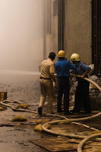 Firefighters during a rescue operation, Gurgaon, Haryana, India : Stock Photo