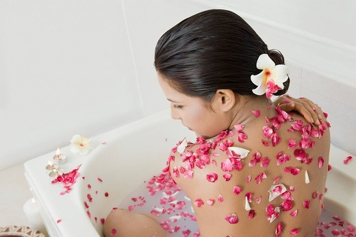Rear view of a woman getting spa treatment : Stock Photo