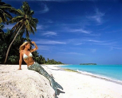 Stock Photo: 1848-101727 Mermaid on the beach, palm trees, Maldives, Indian Ocean