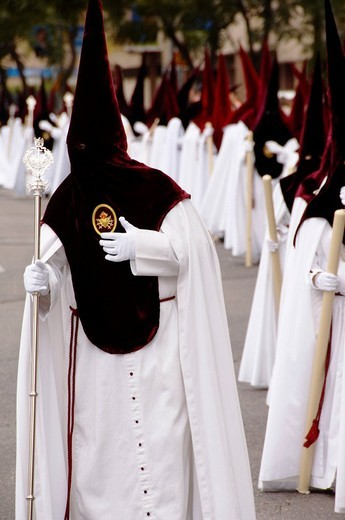 Penitents dressed in penitential robes, nazareno, Holy week procession, Semana Santa, Seville, Andalusia, Spain : Stock Photo