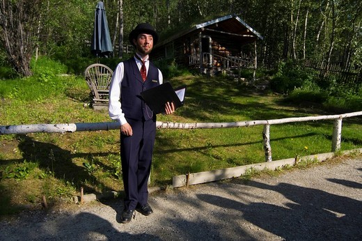 Show, reading at historic Robert Service Cabin, famous Canadian writer, Dawson City, Yukon Territory, Canada, North America : Stock Photo