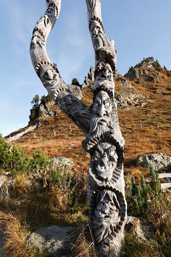 Carved faces near Glockenhuette mountain on Nockalm Road, Nockberge National Park, Carinthia, Austria, Europe : Stock Photo