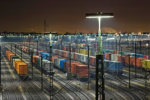 Parked freight trains at Maschen railroad shunting yard near Hamburg at night, Lower Saxony, Germany : Stock Photo