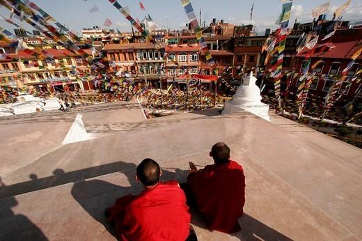 Buddhist monks at the stupa of Bodnath, a northeastern suburb of Kathmandu, Nepal, Asia : Stock Photo