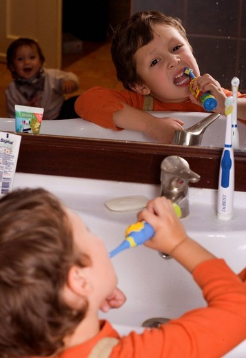 Stock Photo: 1848-103390 Four year old boy brushes his teeth