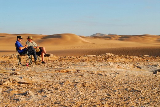 Sundowner in the dunes at Sylvia Hill, Diamond Area, Namibia : Stock Photo