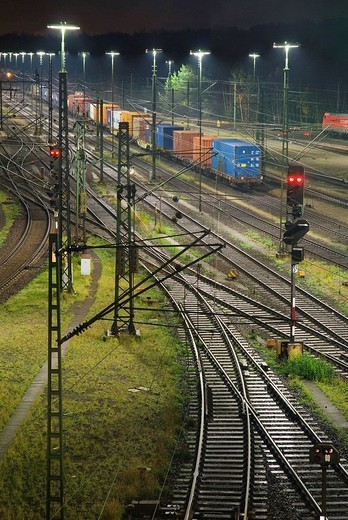Railroad tracks at Maschen railroad shunting yard near Hamburg at night, Lower Saxony, Germany : Stock Photo