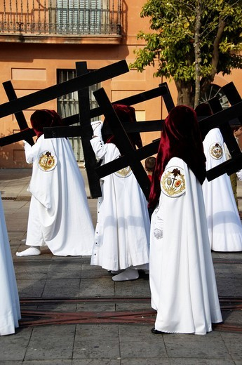 Stock Photo: 1848-103996 Penitents dressed in penitential robes nazareno carrying crosses, Semana Santa, Holy Week Procession, Sevilla, Andalusia, Spain