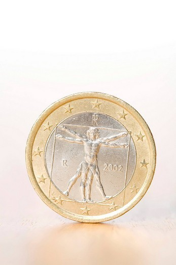 Euro coin on a table : Stock Photo