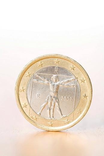 Stock Photo: 1848-10413 Euro coin on a table
