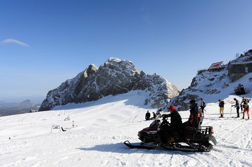 Snowmobile on the Schladming Glacier, view of Mt Koppenkarstein, Dachstein Range, Styria/Upper Austria, Austria, Europe : Stock Photo