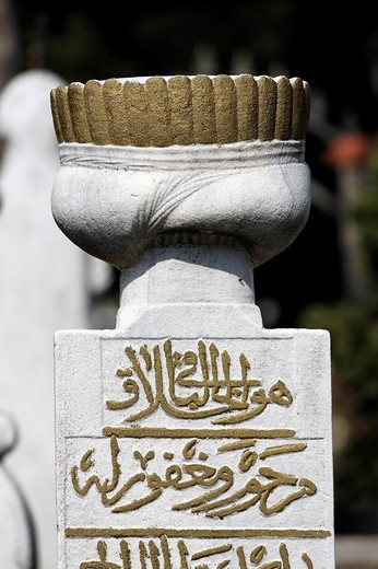 Stock Photo: 1848-104833 Traditional Muslim gravestone with a stylized Ottoman headdress and Arabic characters, Eyuep village, Golden Horn, Istanbul, Turkey