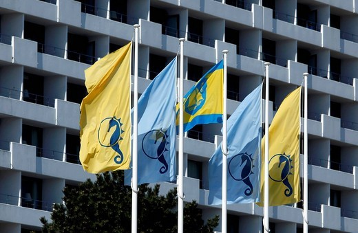 Flags with the logo of the city in front of the Hotel Maritim, Timmendorfer Strand, Ostholstein, Holstein, Schleswig_Holstein, Germany, Europe : Stock Photo