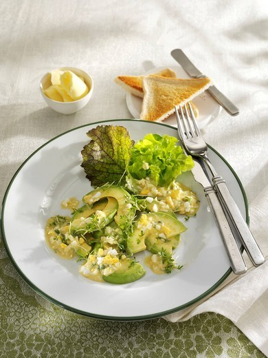 Stock Photo: 1848-105063 Avocado salad with egg sauce, white bread and butter as a side dish