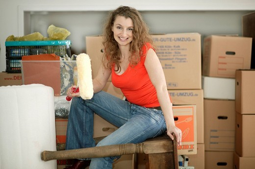 Stock Photo: 1848-105247 Young woman removing