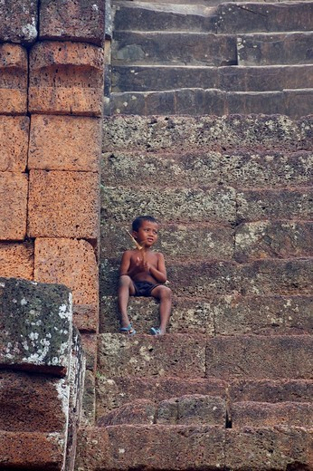 Little boy on the stairs, East Mebon temple, Angkor Wat, Cambodia : Stock Photo