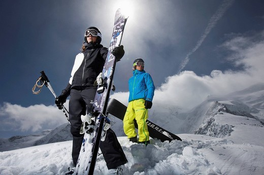 Stock Photo: 1848-10688 Snowboarders, standing in front of dramatic clouds, St. Moritz, Diavolezza, Switzerland, Europe