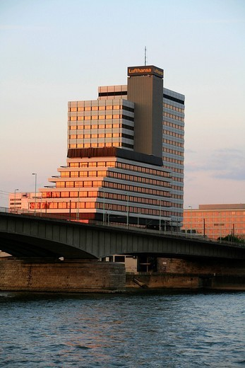 Stock Photo: 1848-108093 Lufthansa high_rise building and Deutzer Bruecke, Deutzer Bridge illuminated by the sunset at the Rhine River, Cologne, North Rhine_Westphalia, Germany, Europe