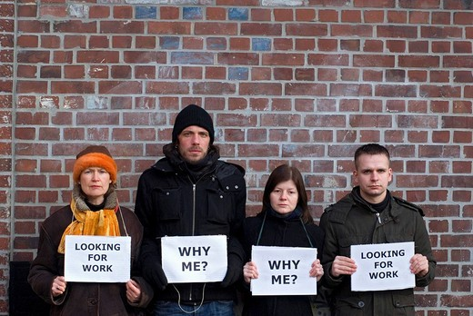 People holding signs with the messages, Looking for work and Why me, symbolic image for the economic crisis : Stock Photo