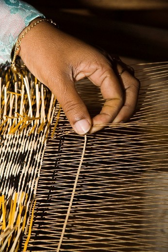 Weaving from coloured straw, the Maledives : Stock Photo