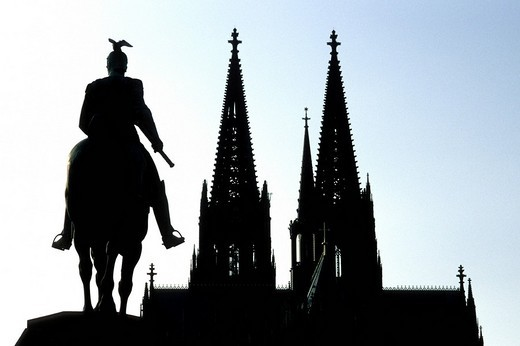 Equestrian statue of Emperor Wilhelm II in backlight, in the back the Koelner Dom Cologne Cathedral, Cologne, North Rhine_Westphalia, Germany, Europe : Stock Photo