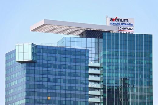 Logos of Avenum, Sanofi Aventis and Schwarz Pharma on an office building in Donau City, Vienna, Austria, Europe : Stock Photo
