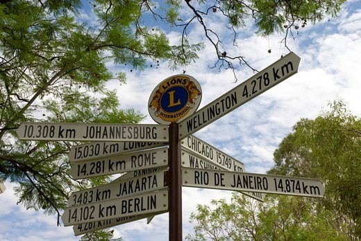 Stock Photo: 1848-111459 Signpost showing kilometer distances to various directions, Alice Springs, Northern Territory, Australia