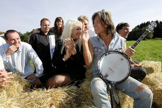 Surprise party for german pop singer Juergen Drews, friends and the band Bella Vista celebrating with him : Stock Photo