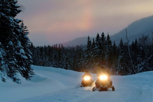 CAN Canada Quebec : Snowmobile driving during winter region Saguenay _ Lac Saint Jean Monts Valin. : Stock Photo