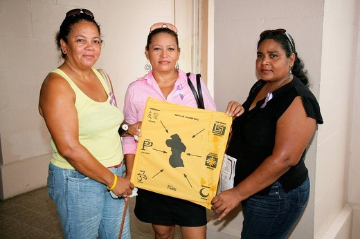 Stock Photo: 1848-111746 Three women of various ethnicities displaying a map of Guyana during a protest against violence against women in Georgetown, Guyana, South America