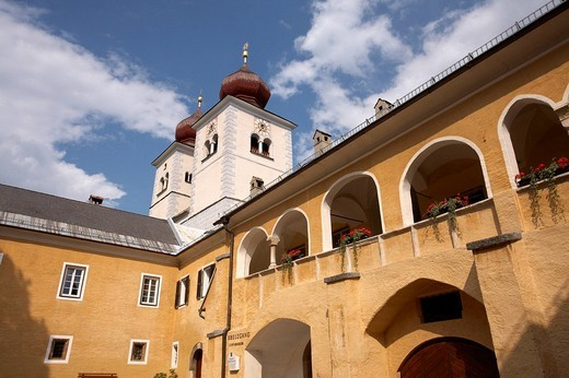 Former monastery Stift Millstatt with steeples of the parish church, Carinthia, Austria : Stock Photo