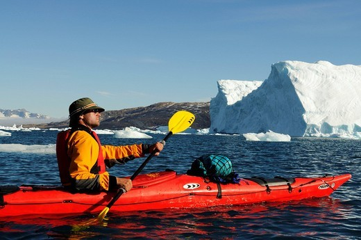 Stock Photo: 1848-114403 Icebergs and kayaker in the Stoklund_Fjord, East Greenland, Greenland