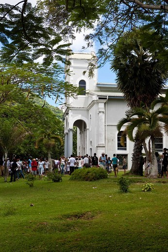 Participants in an Easter procession at the Cathedale Immaculée Conception on Oliver Maradan Street, capital Victoria, Mahe Island, Seychelles, Indian Ocean, Africa : Stock Photo