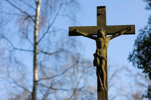Cross, crucifix over a gravestone, Alter Suedfriedhof, old cemetery in Munich, Bavaria, Germany : Stock Photo