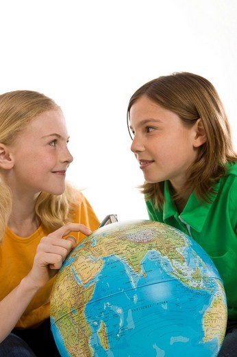 Stock Photo: 1848-116731 Two girls with a globe