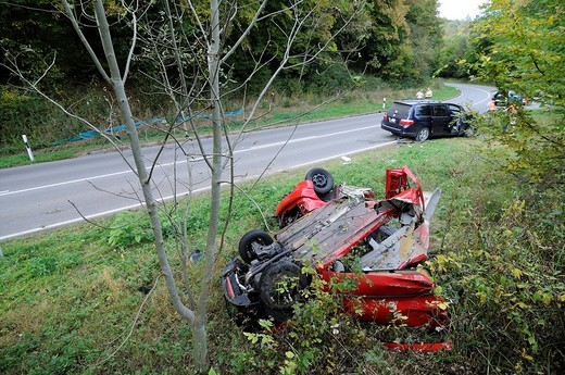 VW Golf having rolled over in traffic accident, torn into two parts, Sindelfingen, Baden_Wuerttemberg, Germany, Europe : Stock Photo
