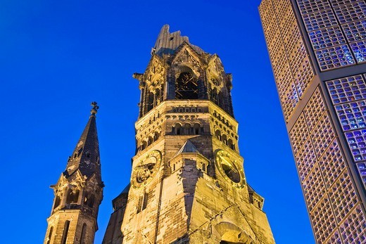 Emperor Wilhelm Memory Church, old and new building on Breitscheidplatz in Berlin, Germany : Stock Photo