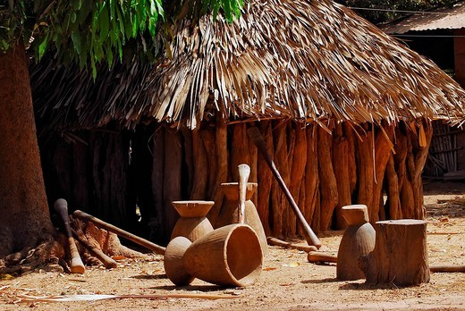 African hut with equipment for mashing cassava, Tunami Tenda, The Gambia, Africa : Stock Photo