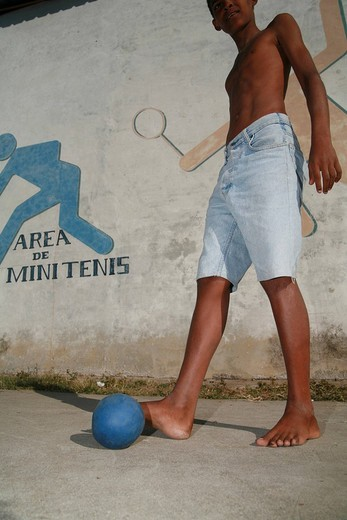 Stock Photo: 1848-117849 Boy playing football in Cienfuegos, Cuba, Caribbean, Americas