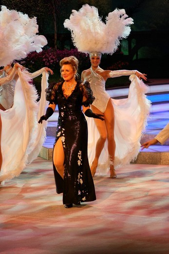 Angela Wiedl performing during her revue together with the MDR Television Ballet during the Fruehlingsfest der Volksmusik or Spring Folk Music Festival, Erdgas_Arena, Riesa, Saxony, Germany, Europe : Stock Photo