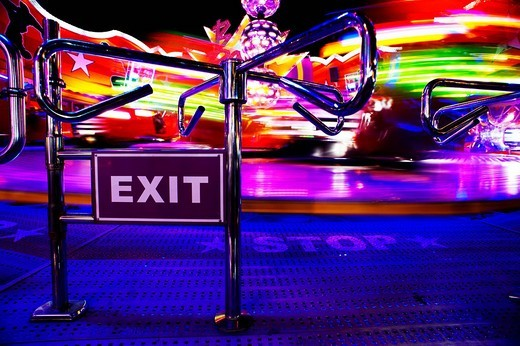 Exit sign in front of the speed ride at night in Vienna Prater Park, Vienna, Austria, Europe : Stock Photo