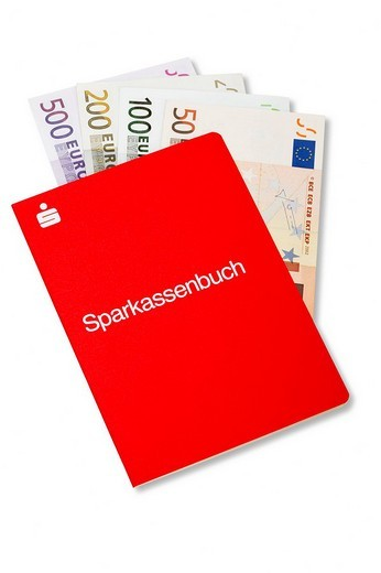 Bank book with Euro bills : Stock Photo