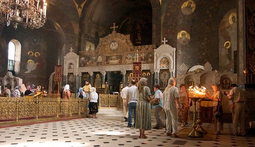 Ukraine Kiev the monastery of cave Kyjevo Pecers´ka Lavra believers praying in the church sacrifice candles 2004 : Stock Photo