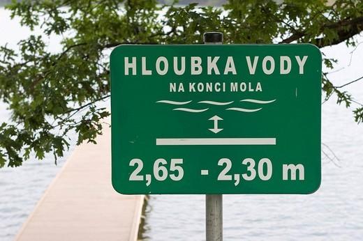 Warning sign water depth, Alum Lake, Czech Republic : Stock Photo