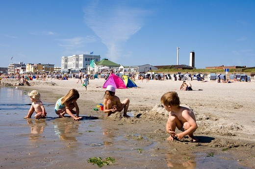 Children playing on Weststrand beach, Norderney, East Frisian Islands, Lower Saxony, Germany, Europe : Stock Photo
