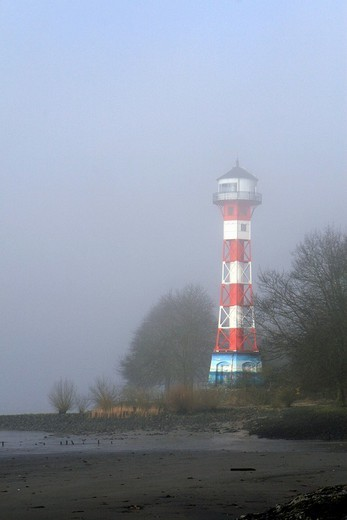 Lighthouse in fog on the banks of the River Elbe near Hamburg, Germany : Stock Photo