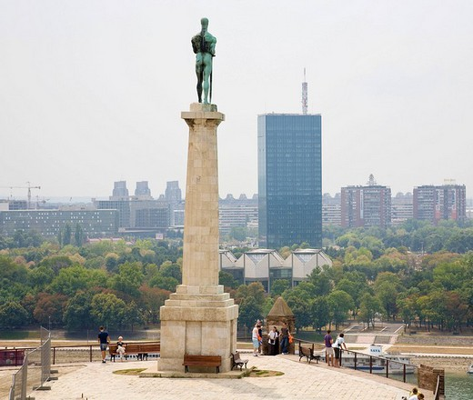 Monument to The Victor in the Kalemegdan park, facing the multistory buildings of the Novi Beograd district, Belgrade, Serbia : Stock Photo